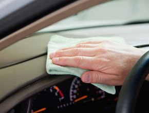 hand wiping dashboard